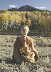 C.C. havens sitting naked in meditation with  cape drape.
